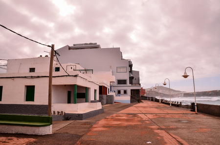 costal: Typical Colored Colonial Spanish Building with Flat Roof