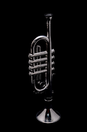 Silver Vintage Toy Trumpet on a Black Background
