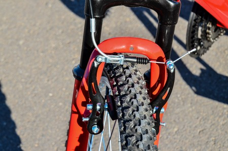 damper: Close up of Modern Red Full Suspension Mountain Bike MTB Bicycle Stock Photo