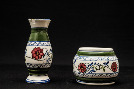Colorful designed clay vase over a Black background photo
