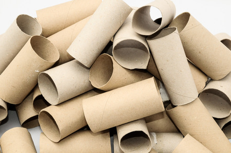 paper roll: Empty Toilet Rolls Stack Up On a Black Background