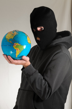 Black Dressed Young Man Holding a Globe Earth photo