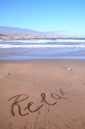 sand writing: Relax writing on sand Stock Photo