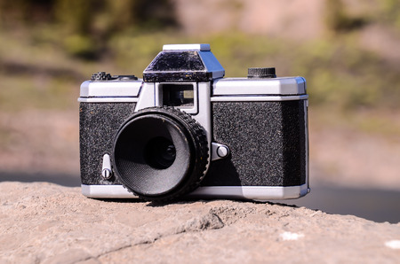 Photography Concept Classic Vintage 35mm Gray Plastic Camera photo