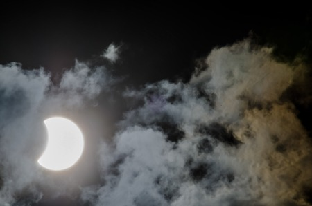 partial: Partial Solar Eclipse on a Cloudy Day
