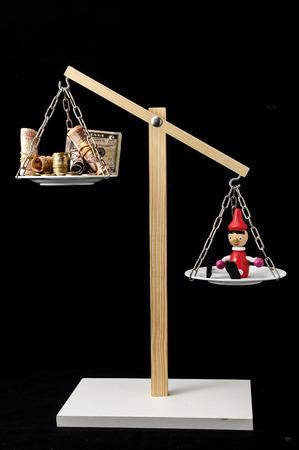 pinocchio: Liar Concept Pinocchio and Money on a Two Pan Balance Stock Photo