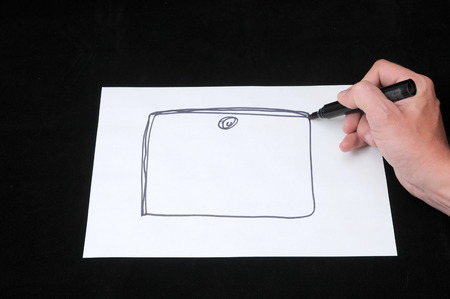 A Caucasian Male Hand Drawing on a White Paper photo