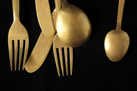 Ancient Vintage Silver Flatware on a Black Background photo