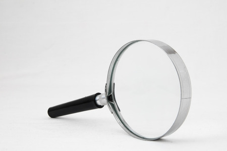 low scale: Magnifying Glass Loupe on a White Background