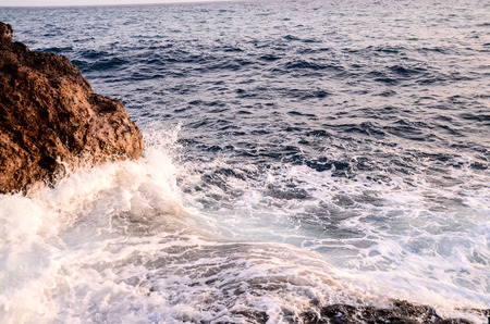 briny: Strong Waves Crashing on the Volcanic Coast in Tenerife Canary Islands Stock Photo