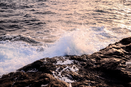 eruptive: Strong Waves Crashing on the Volcanic Coast in Tenerife Canary Islands Stock Photo