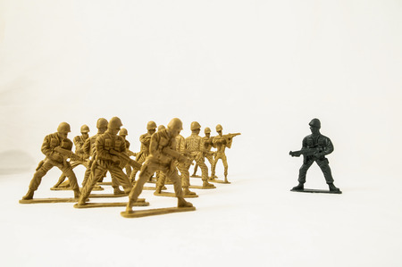 plastic soldier: Plastic Lead Soldiers Representing War on a White Background