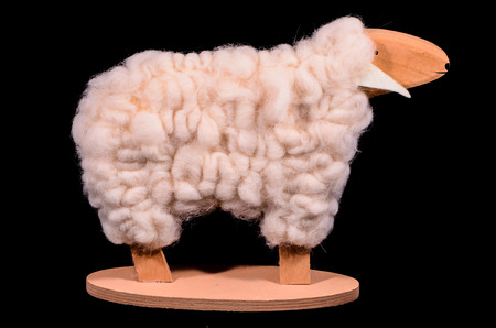 wooden handmade: Wooden Handmade Statue of a Sheep on Black Background