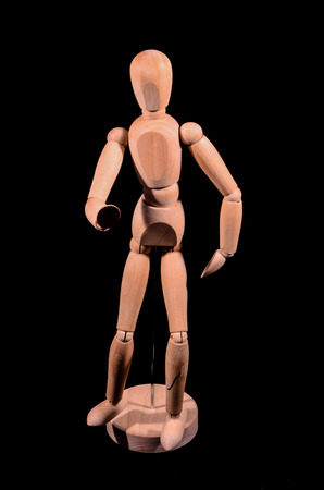artists dummy: Wooden Brown Art Mannequin Isolated on Black Background