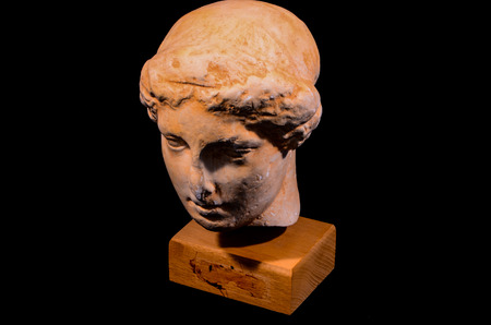 head stones: Head of the Ancient Greek Statue Isolated on a Black Background Stock Photo