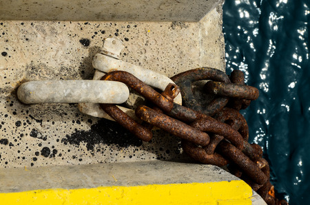 rusty chain: Rusty Ship Anchor Chain On Dry Coast In The Port Stock Photo