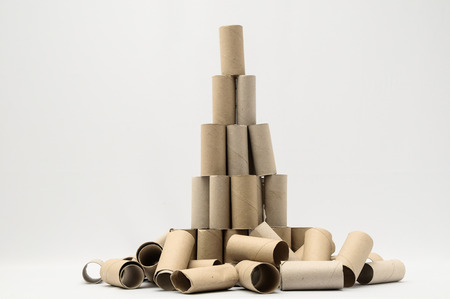toilet paper: Empty Toilet Rolls Stack Up On a Black Background
