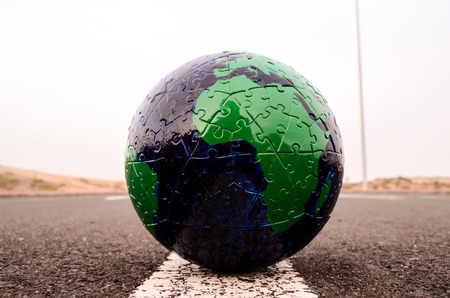 Conceptual Image Globe Earth on an Asphalt Street photo