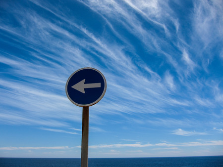 cloudscapes: Wndy Clouds and One Way Sign On The Evening Atlantic Ocean Sky