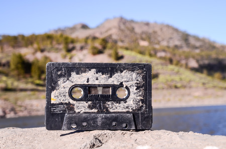 Ancient Retro Musicassette on the Rock into the Wild photo