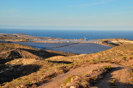 Renewable Energy Concept Solar Panels Field at Sunset Stock Photo