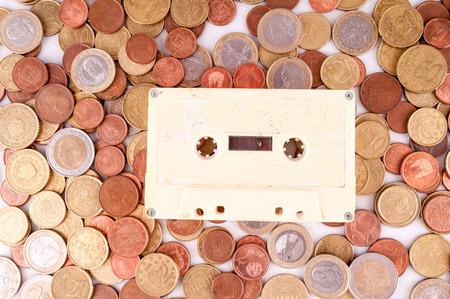 money concept: Picture of a Business Money Concept Idea Musicassette Tape and Coin