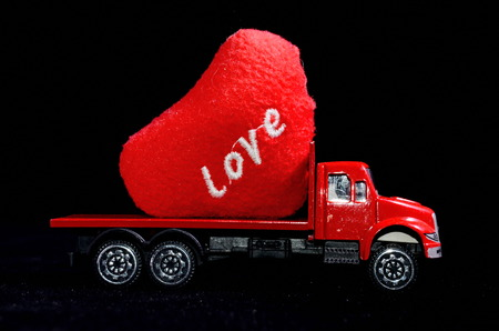 Love Concept of Truck Loading Lovely Heart, A Perfect Gift or Present for Someone Special. photo