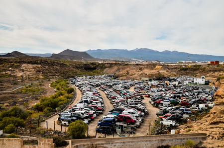 pile reuse engine: Scrap Yard With Pile Of Crushed Cars in tenerife canary islands spain