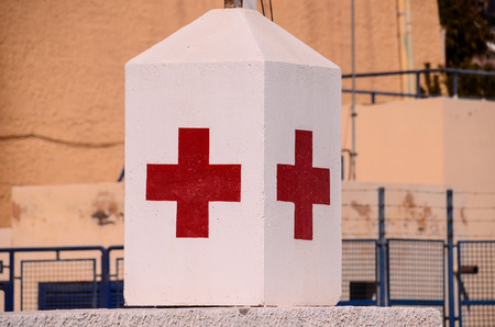 red cross: Red Cross Medical Sign Over a White Background