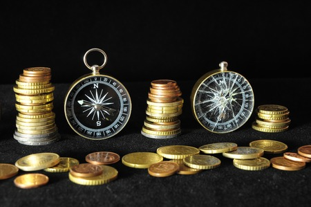 monies: Orientation in Business Compass and Money on a Black Background