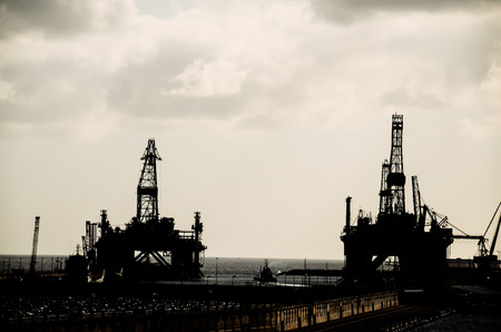 Oil Drilling Rig Silhouette over a Cloudy Sky