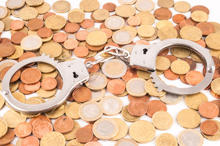 money concept: Picture of a Business Money Concept Idea Conis and Handcuffs