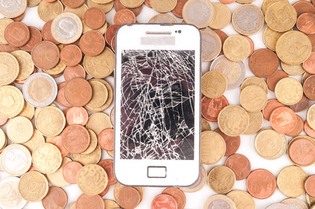 money concept: Picture of a Business Money Concept Idea, Smartphone and Coins Stock Photo