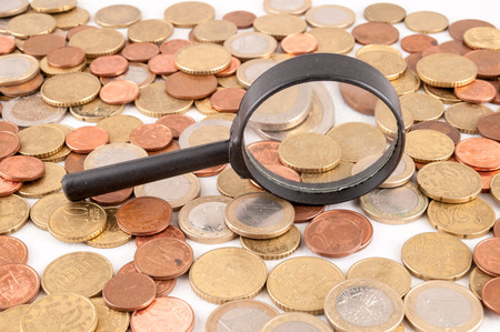 Picture of a Business Money Concept Idea Conis and Magnify Glass photo