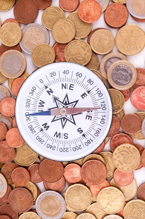money concept: Picture of a Business Money Concept Idea Coins and Compass