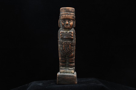 One Ancient Mayan Statue on a Black Background