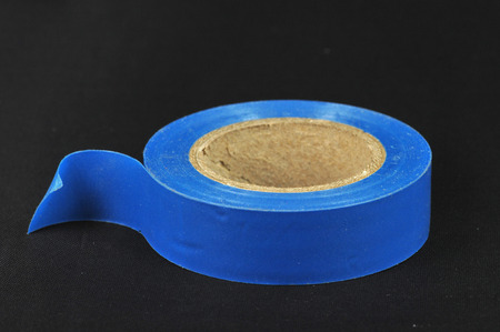 sellotape: Picture of a tape roll on a dark background