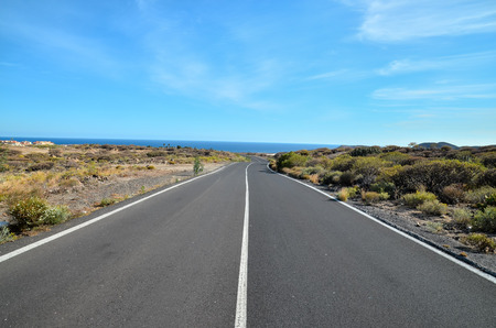 Long Empty Desert Asphalt Road in Canary Islands Spain Imagens - 40788381