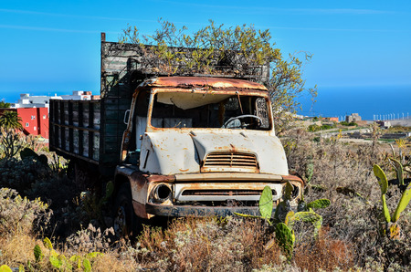 oldie: Rusty Abandoned Truck on the Desert, in Canary Islands, Spain Stock Photo