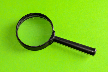 magnify glass: Vintage Magnify Glass Loupe on a Colored Background