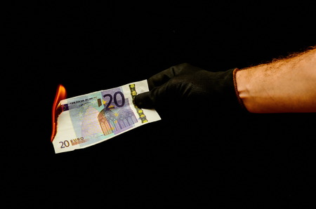 money to burn: European Euro Money Banknote Currency and Right Hand