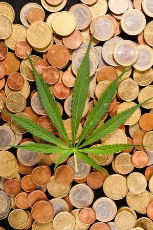 unlawful: Picture of Marijuana and Money Cannabis Business Concept Stock Photo