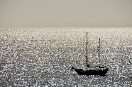 backlight: Backlight Picture of a Silhouette Boat in the Ocean