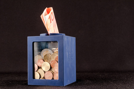 money concept: Picture of a Business Money Concept Idea Coin Container