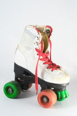 consumed: Used Vintage Consumed Roller Skate on a White Background