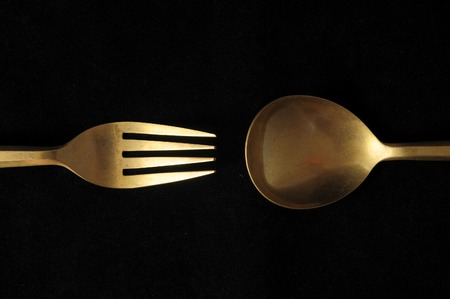 grunge cutlery: Ancient Vintage Silver Flatware on a Black Background