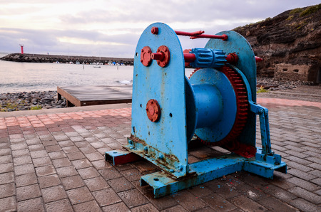 windlass: Old Vintage Metal Winch in a Port Harbor