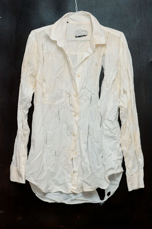 messy clothes: Old Vintage Ruined Grunge White Shirt Clothes Stock Photo