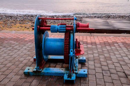 winch: Old Vintage Metal Winch in a Port Harbor