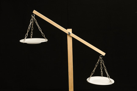 counterweight: Two White Pan Balance on a Black Background Stock Photo